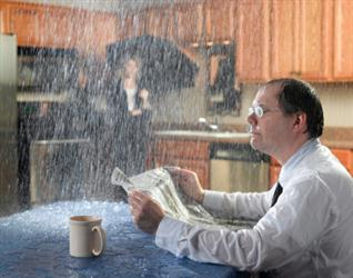 People in need of roof repair in East Templeton MA. Leaky roof causing it to rain on people in their kitchen. Humorous.
